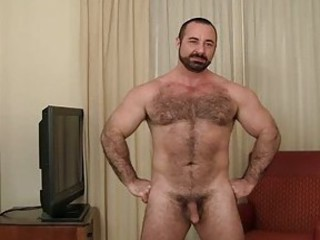 Bearded gay bear strips in his living room / 715